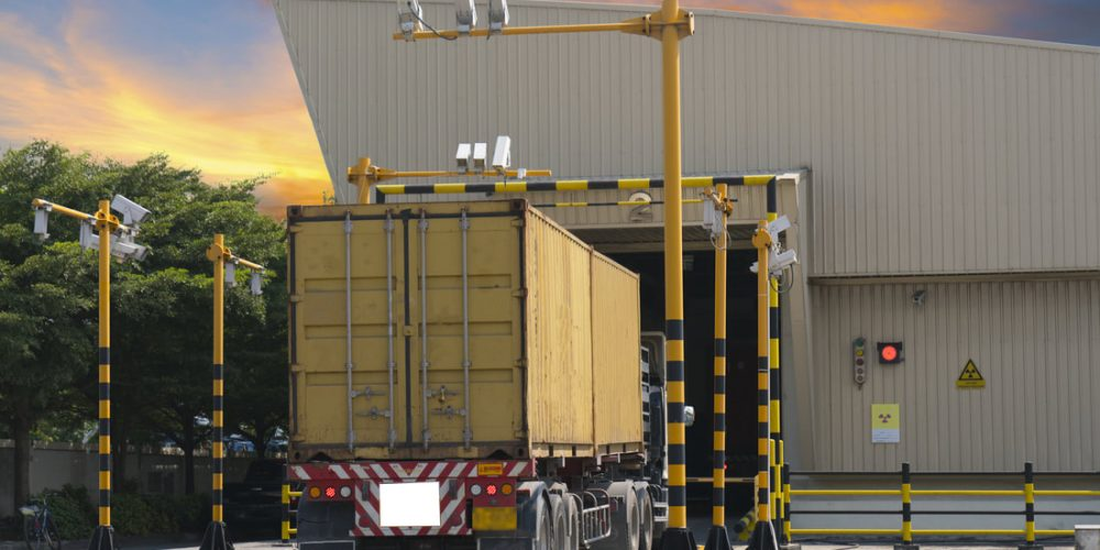 an image of the back of a cargo truck entering a warehouse